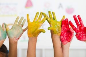 Colourful kids hands painted