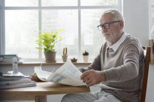 Mature man reading the newspaper