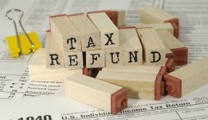 Tax refund written on wooden markers