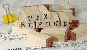Tax refund written on wooden markers